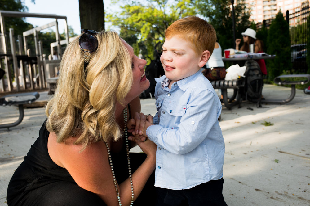 Jessica Klein-Foglio smiles with her son, Benjamin, at Skyview-on-the-Hudson's playground. Benjamin, 3, has Salla disease, a rare affliction that causes physical and intellectual impairments. His mother, an accomplished singer, is creating a nonprofit to help children like her son.