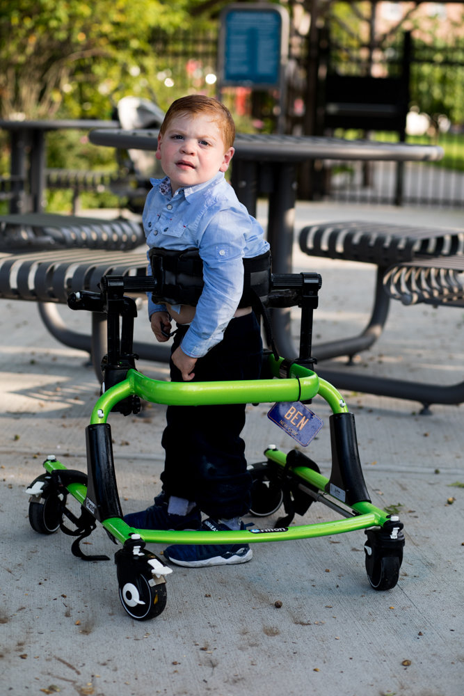 Benjamin Klein-Foglio, 3, walks in his walker at Skyview-on-the-Hudson's playground. He has Salla disease, which causes physical and intellectual impairments. His mother, an accomplished singer, is creating a foundation to help children like her son.