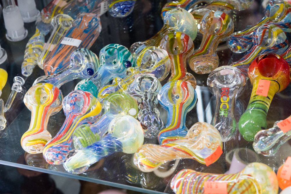 Chromatic pipes sit in a display case at Quick Stop Smoke Shop on West 231st Street in Kingsbridge. Sam Alsayedi, who identifies himself as the shop's owner, says legalization of marijuana would make the neighborhood safer because people looking to buy could do so at a legitimate business.