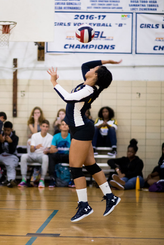 Krystal Paulino, Riverdale/Kingsbridge Academy's senior captain, prepares to serve in the Lady Tigers' straight-set win over Comprehensive Model High School last week.
