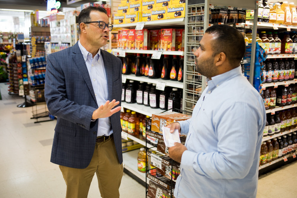 Councilman Andy Cohen speaks with Jaime Luna, the store manager of the Key Food in the Skyview Shopping Center.