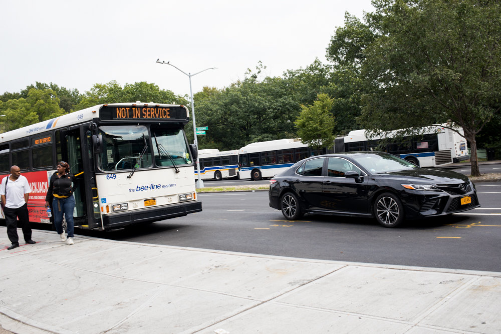 A car loops in front of a Westchester County Bee-Line bus dropping off passengers at a bus bulb located on the southbound side of Broadway near West 242nd Street. The bulb not only has created some problems with traffic, according to some local business owners, but it's also pulled away much-needed parking.