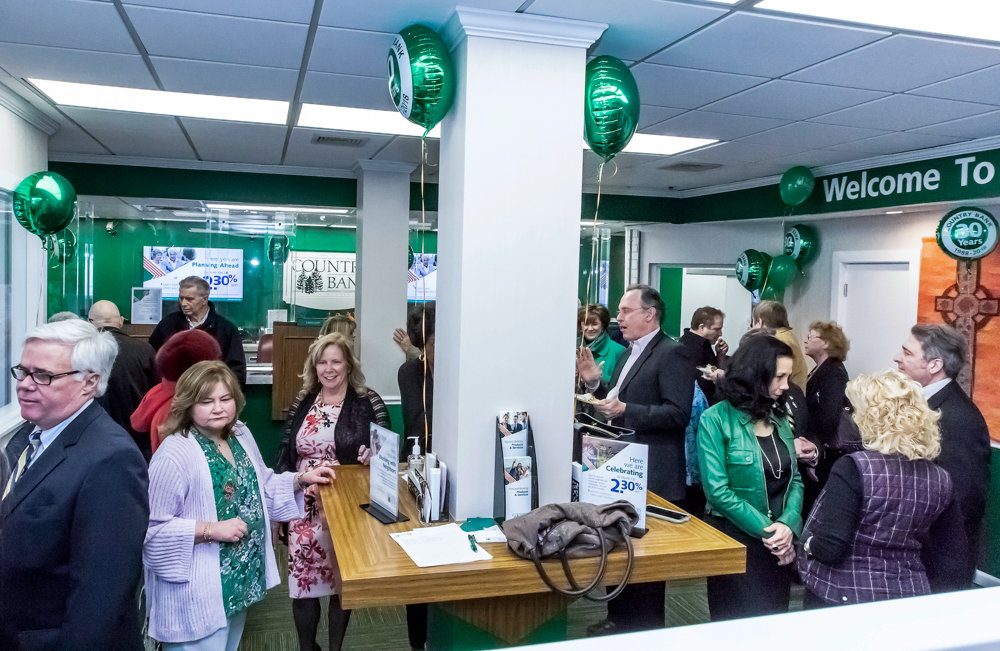 Country Bank employees celebrate the institution's 30th anniversary at its Woodlawn location.