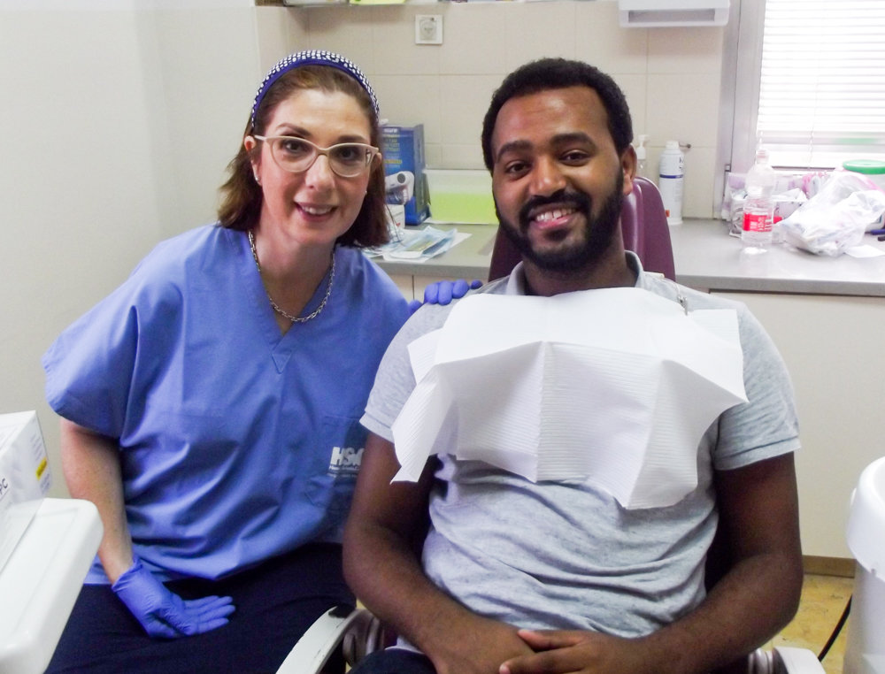 Dentist Sandra Molinas smiles with a patient at a clinic in Jerusalem. Molinas recently traveled to Israel as part of the Dental Volunteers for Israel program, which provides free dental care to those who need it, and which Molinas has been a volunteer for more than five years.