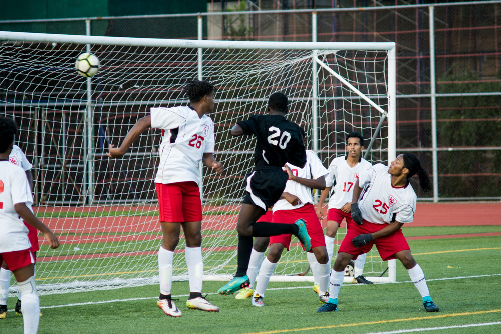 Clinton's Yankuba Konteh (20) scores on a header off a corner kick in the Governors' 3-2 win over Kennedy.