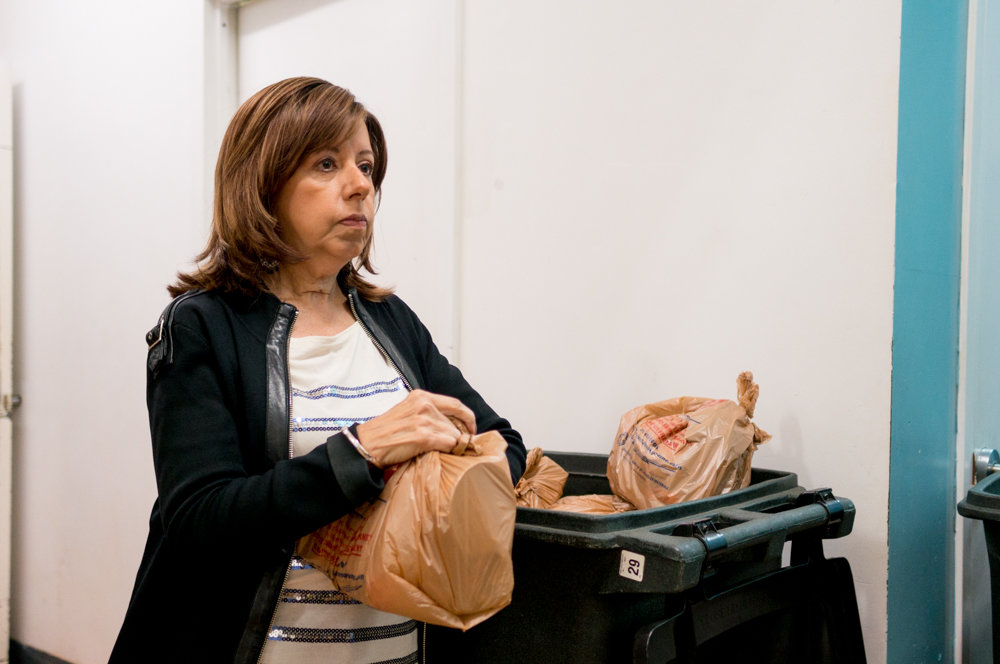 Nellie Kearney waits to distribute bags of groceries to local residents at the Episcopal Church of the Mediator in Kingsbridge last year. Kearney is a volunteer with the Kingsbridge Riverdale Marble Hill Food & Hunger Project, a group that is hosting a benefit concert Oct. 14 at the Riverdale-Yonkers Society for Ethical Culture.