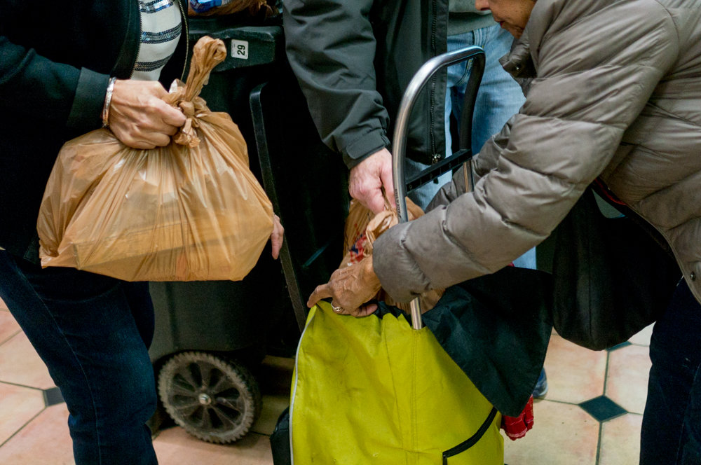 Volunteers with the Kingsbridge Riverdale Marble Hill Food & Hunger Project distribute bags of groceries to local residents on food stamps last year. KRMH is hosting a benefit concert Oct. 14 at the Riverdale-Yonkers Society for Ethical Culture.