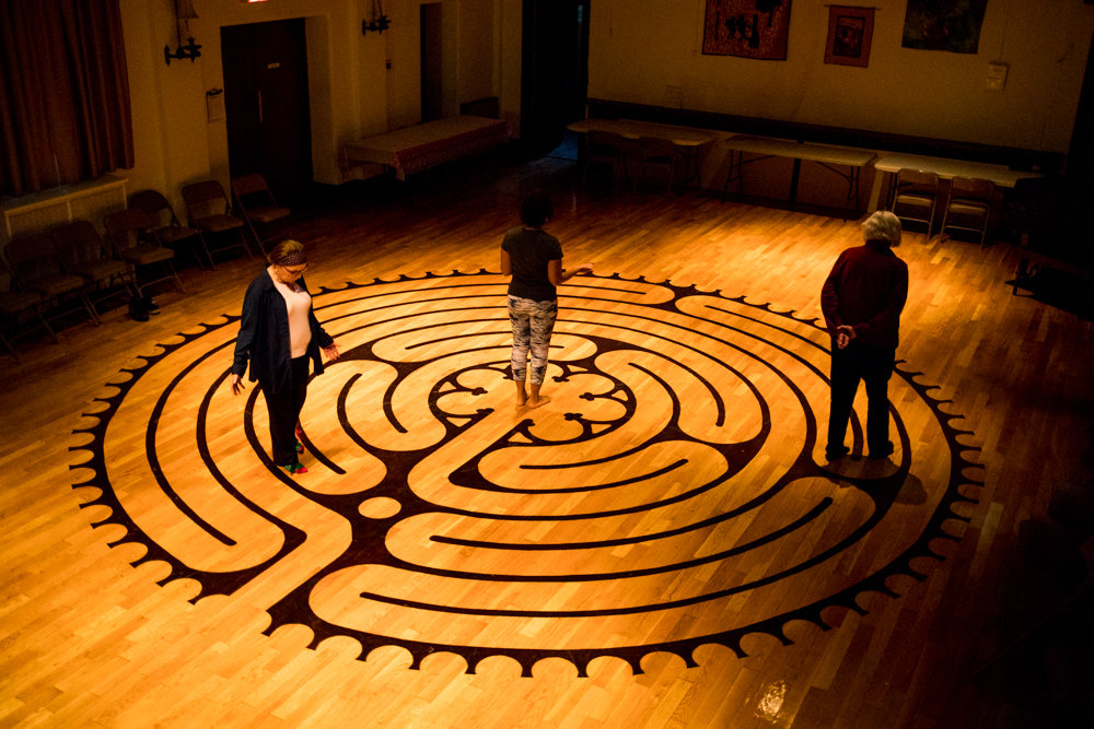 Parishioners walk through the labyrinth at Christ Church Riverdale. The design, inspired by the labyrinth at the Chartres Cathedral in France, is open every Tuesday evening from 6 to 8.