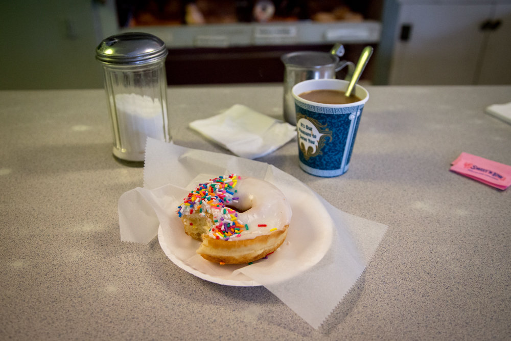 Since his return to Riverdale and the surrounding neighborhoods as a photojournalist, Eian Kantor finds the Kingsbridge Donut Shop to be one of his new favorite places. 'Every time I've gone in, I've sat at the counter and had a conversation for over an hour with a stranger,' he says.