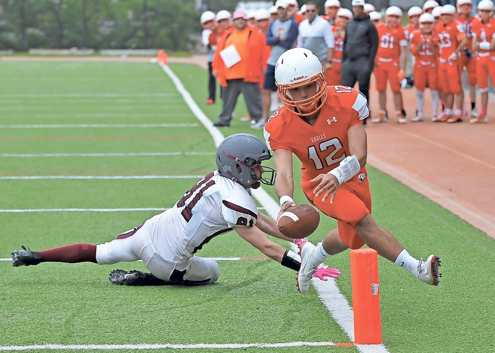 Fieldston quarterback Jesse Cooper-Leary tries to wave the football over the end zone marker on his team's way to earning King of the Hill bragging rights in a 48-30 win over Riverdale Country School.