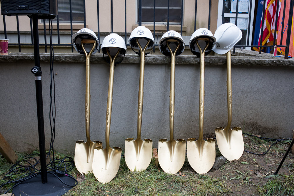 New York Public Library-branded construction helmets rest on gold shovels ahead of a ceremonial groundbreaking ceremony for the site of the Van Cortlandt Library's new location at 3882 Cannon Place.