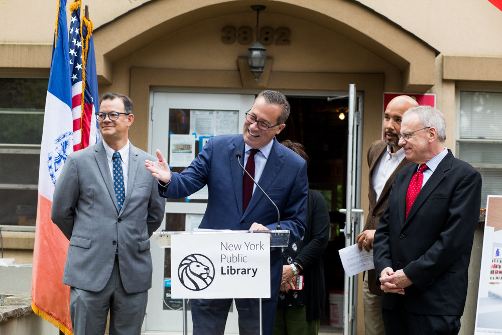 Anthony Marx, president of the New York Public Library, commends Van Cortlandt Library manager Peter Pamphile for his service to the community. The site of the new Van Cortlandt Village branch will be at 3882 Cannon Place.