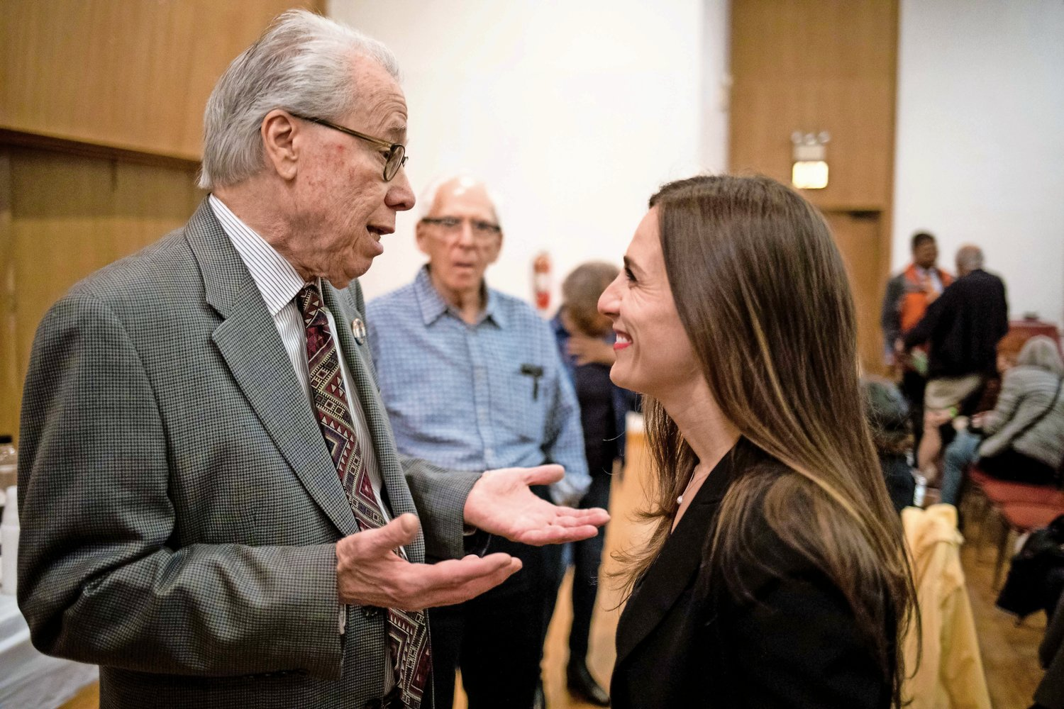 Alessandra Biaggi speaks with Bruce Feld, the vice president of the Benjamin Franklin Reform Democratic Club, ahead of the club?s endorsement meeting on April 25. Biaggi did not secure the club?s nomination, but ultimately defeated her opponent, state Sen. Jeff Klein, in the primary on Sept. 13.