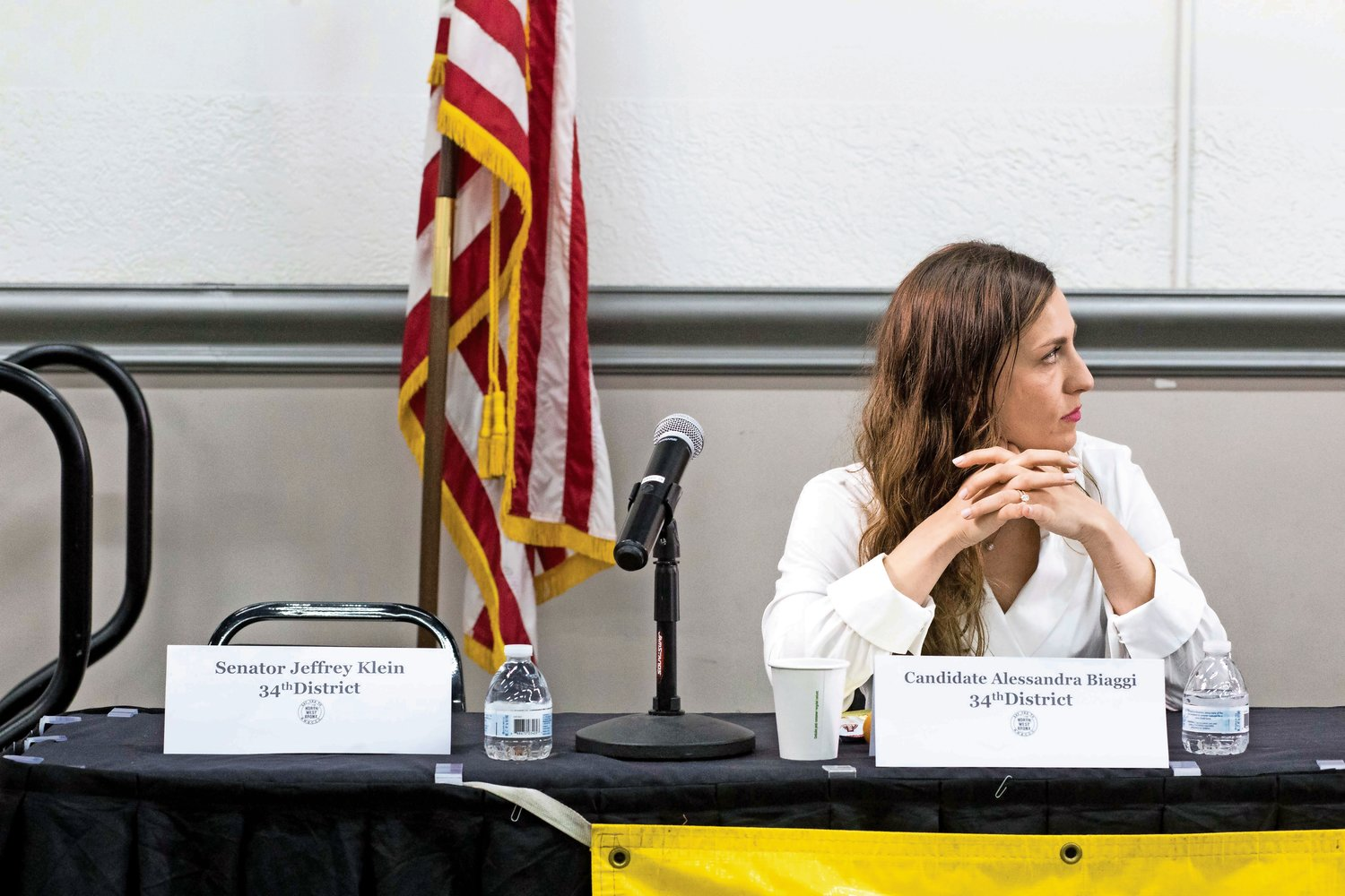 Alessandra Biaggi sits on the panel at a nonpartisan candidates forum held by the Northwest Bronx Community and Clergy Coalition on Aug. 22 next to a seat reserved for state Sen. Jeffrey Klein, who didn?t attend in August.
