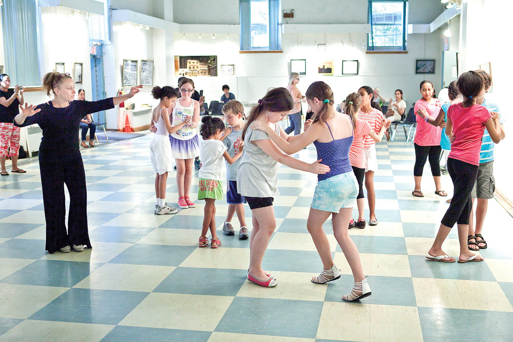 Evangelina Rivera teaches tango to her class at the Bronx Arts Ensemble's dance workshop at Vladeck Hall in 2013. The organization offers a range of programs with this year's season focused on Mexican music.