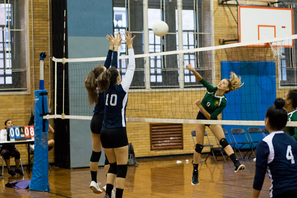 Bronx Science sophomore Anya Lollos delivers one of her seven kills for the Wolverines in their 25-16, 25-22 straight-set victory over Columbus.