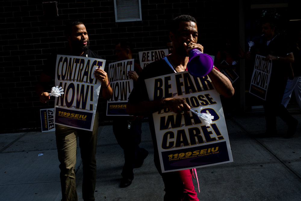 A health care worker with 1199SEIU leads a chant during a protest outside of Citadel Rehabilitation and Nursing Center at Kingsbridge. They are calling for increased staffing and wages.