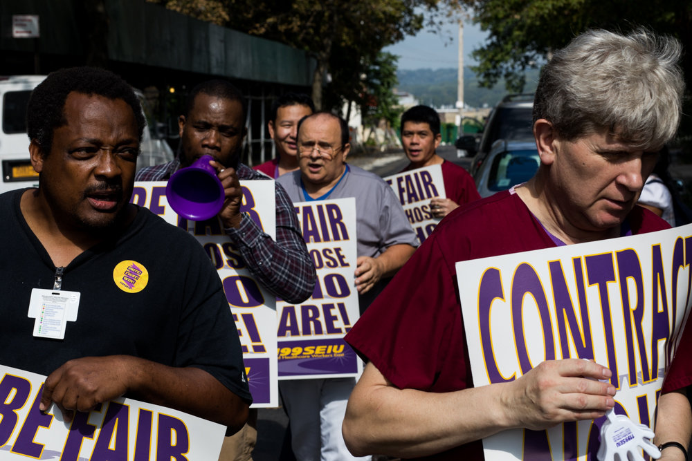 Health care workers with 1199SEIU stage an 'informational' picket outside of Citadel Rehabilitation and Nursing Center at Kingsbridge, one of a number of 'informational pickets in New York City on Oct. 10.