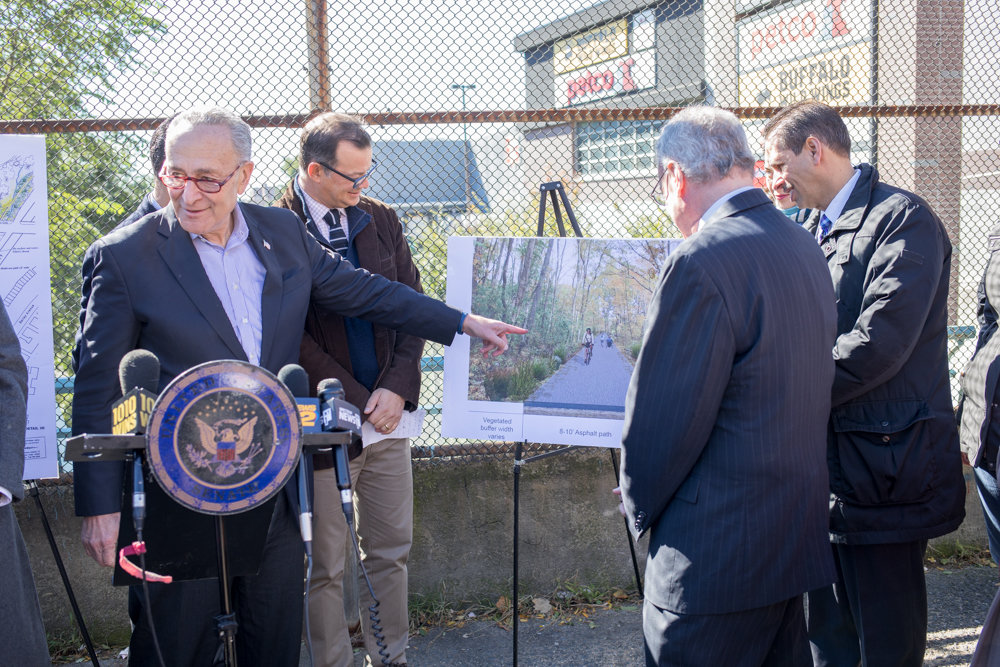 U.S. Sen. Charles Schumer, an avowedly avid cyclist, points to a placard depicting a bike path during a press conference regarding a proposed deal to purchase a strip of land owned by Florida-based holding company CSX Corp. The two entities had agreed to enlist an independent appraiser to determine a fair price for the parcel, but CSX backed out of the agreement after the price was named last December, according to Schumer's office.