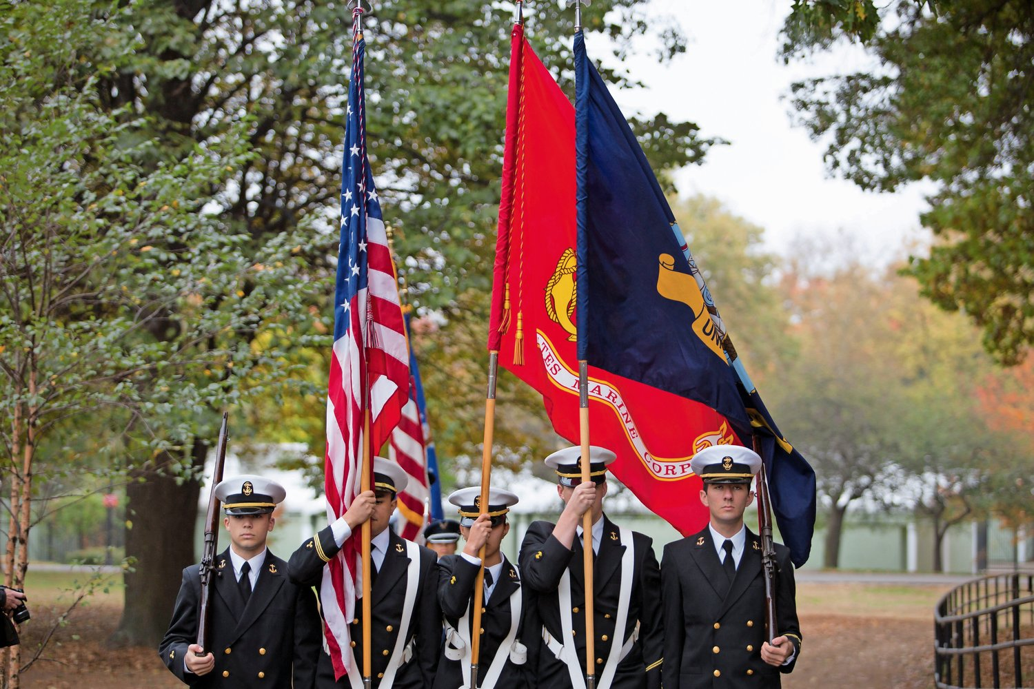 SUNY Maritime Navy ROTC members present the colors at the opening of a Veterans Day ceremony at Memorial Grove last year. Local veteran Herb Barrett first organized the ceremony in 2007 when he sought to restore the Van Cortlandt Park location with his friend and fellow veteran, the late Donald Tannen.
