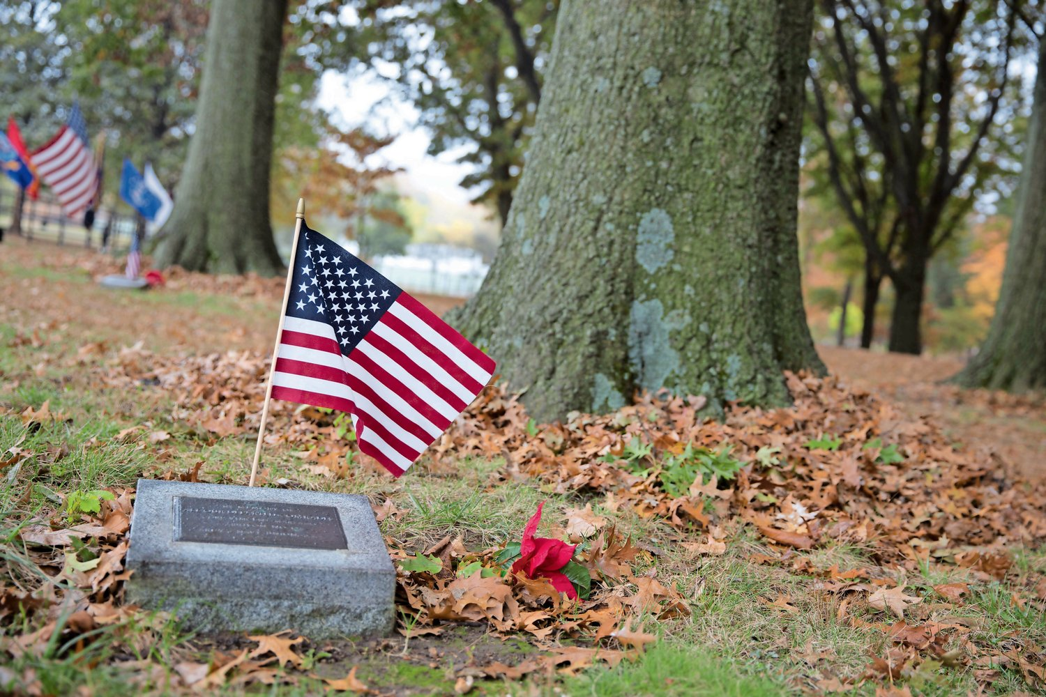A World War II memorial in Memorial Grove, decorated by Herb Barrett, honors the memory of fallen soldiers.