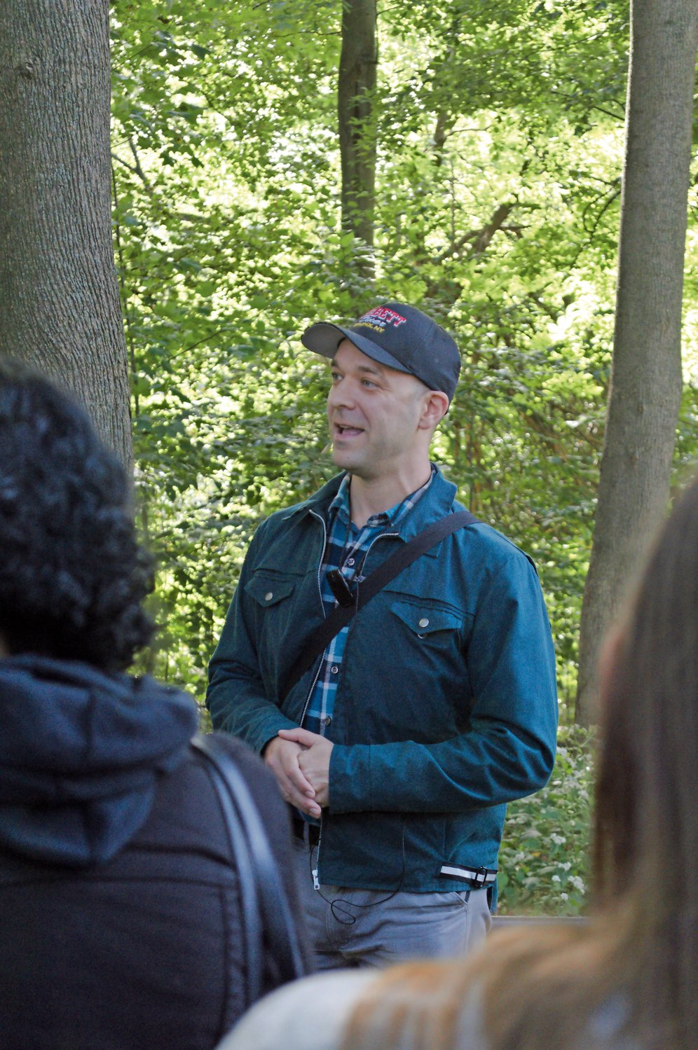 Nick Dembowski, new president of the Kingsbridge Historical Society, talks about an overgrown burial site in Van Cortlandt Park during a tour of the park on Oct. 14.