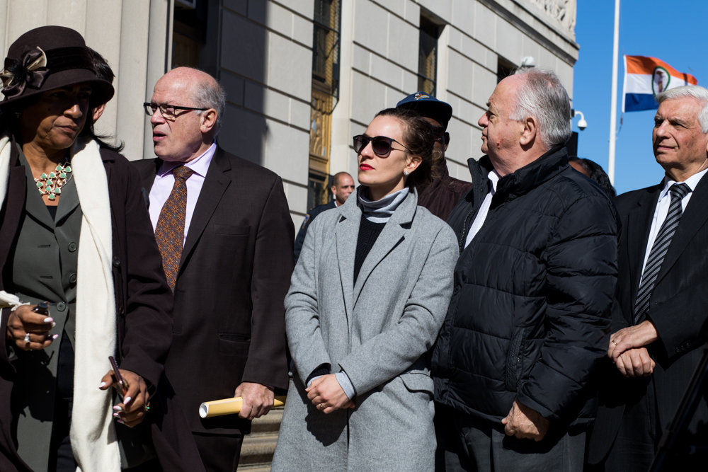 State senate candidate Alessandra Biaggi, center, attends a prayer vigil Tuesday for the mass shooting victims at the Tree of Life Synagogue in Pittsburgh. The alleged shooter, identified by police as Robert Bowers, gunned down 11 worshippers last Saturday and upon his surrender reportedly told police he 'wanted all Jews to die.'