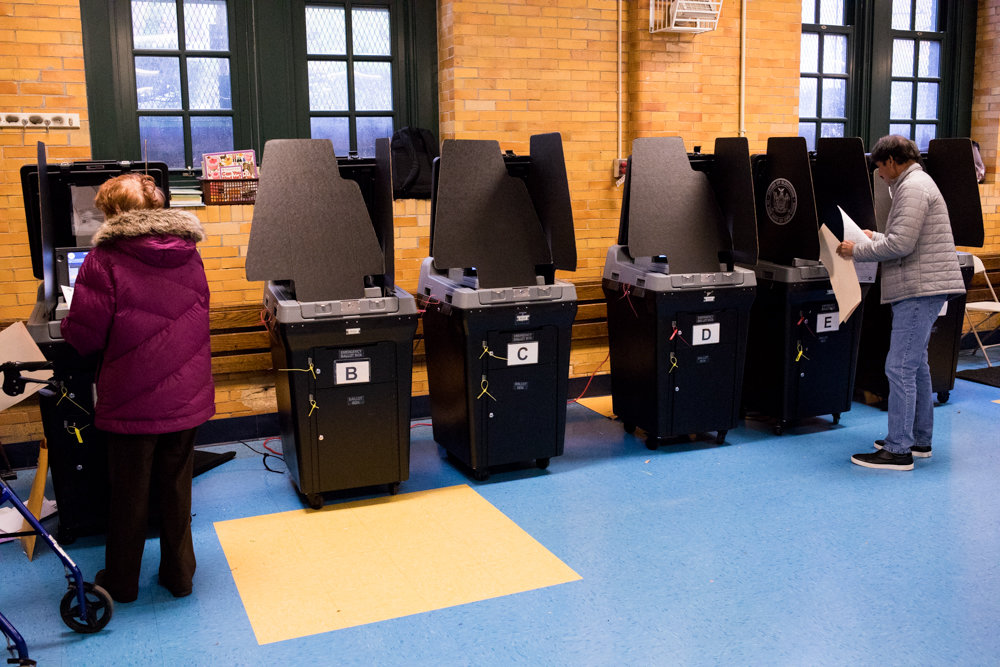 By the early afternoon on Election Day, only two of six ballot scanners were working at P.S. 81 Robert J. Christen School on Riverdale Avenue, where the line of voters snaked around the room with people waiting to scan their ballots.