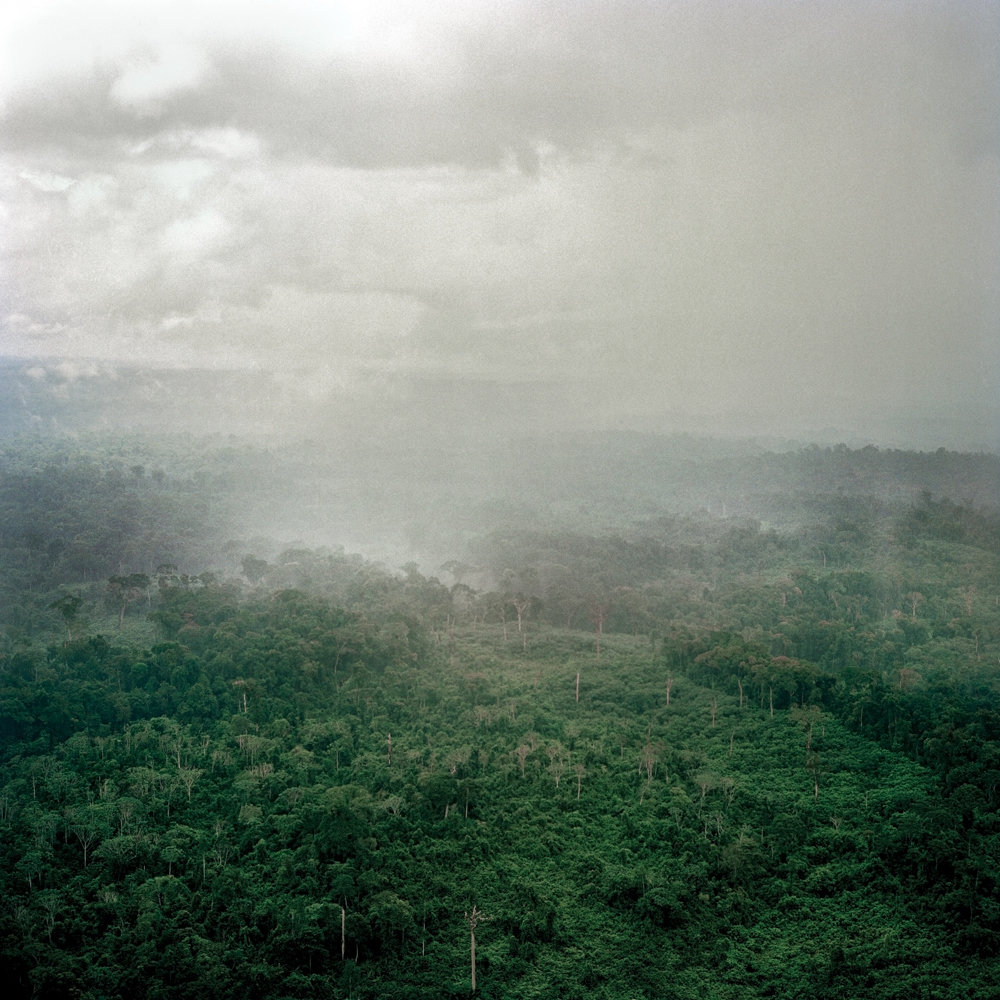 Rain clouds gather over the forest near Fish Town, Liberia, in 2005. This image is included in the exhibition 'War and Peace in Liberia' at the Bronx Documentary Center, which is on display through Dec. 16.