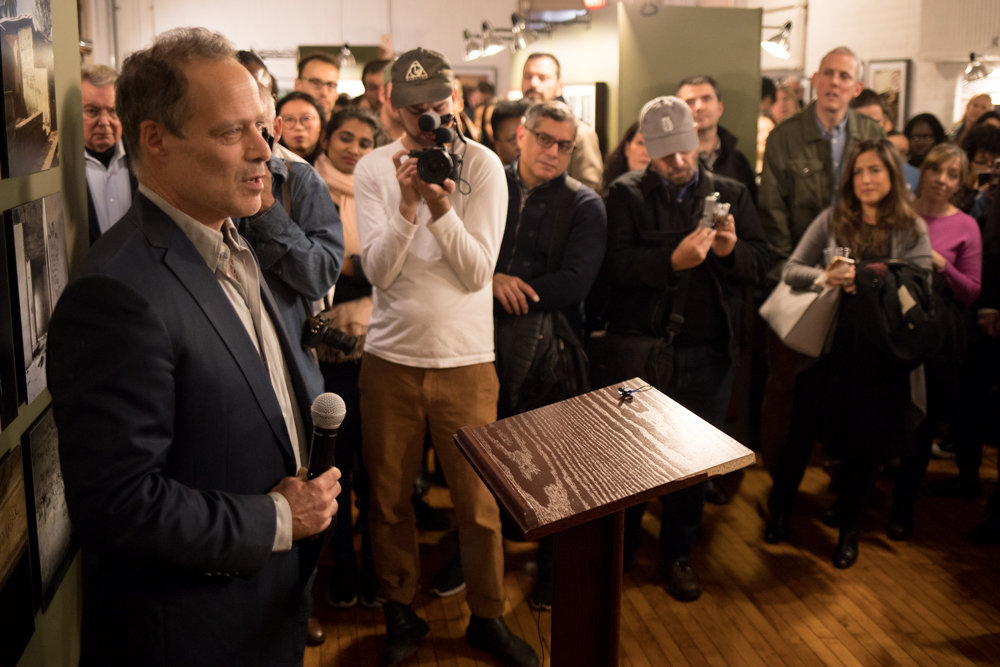 Sebastian Junger — an author, journalist and filmmaker — speaks about his colleague and friend Tim Hetherington at the opening of the exhibition 'War and Peace in Liberia,' which features the work of Hetherington and Chris Hondros. It's on display at the Bronx Documentary Center through Dec. 16.