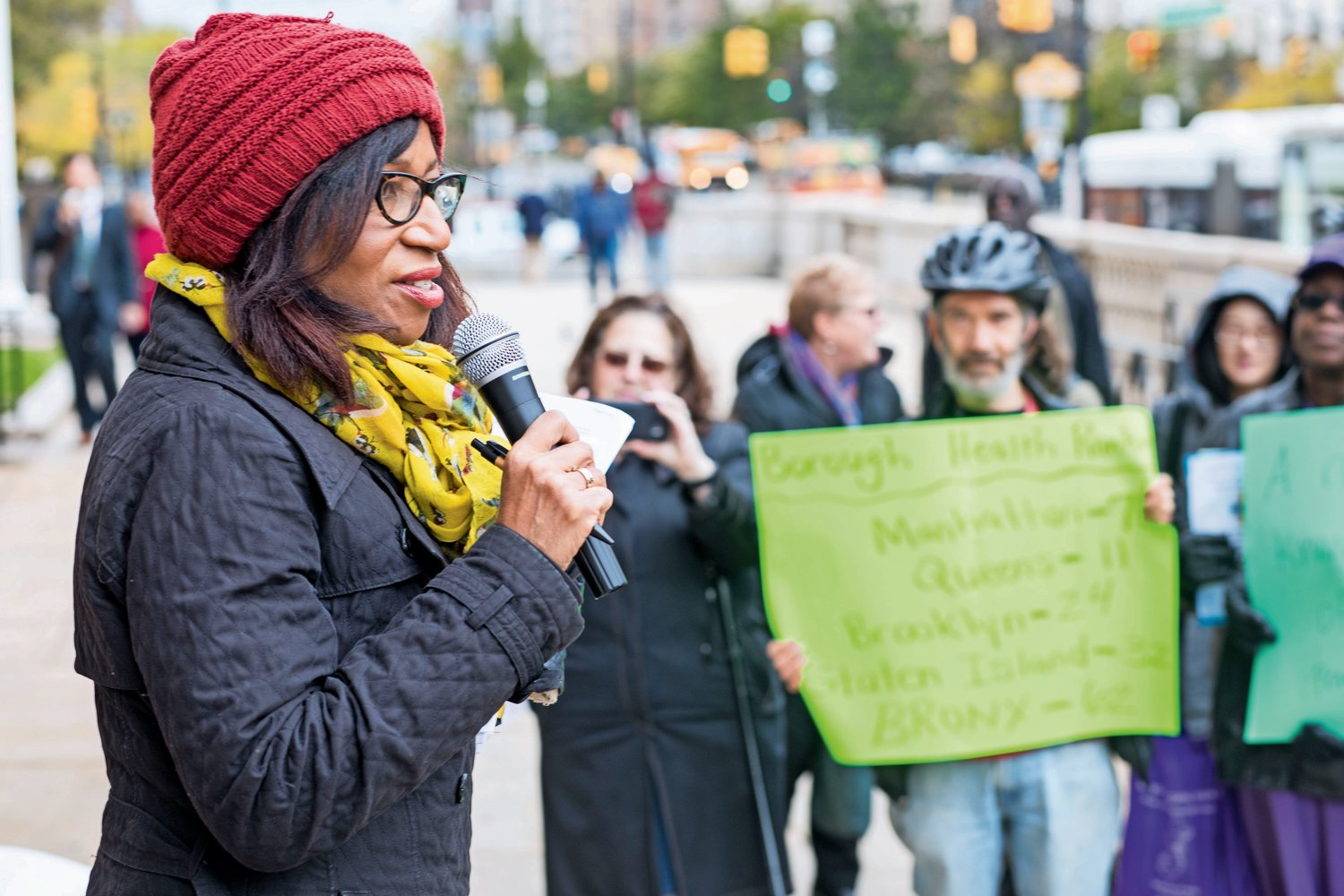 Charmaine Ruddock, the project director for Bronx Health Reach, speaks at a rally calling for improvements in healthcare in the Bronx, which ranks last out of the 62 counties in New York State in the County Health Rankings and Roadmaps Report.