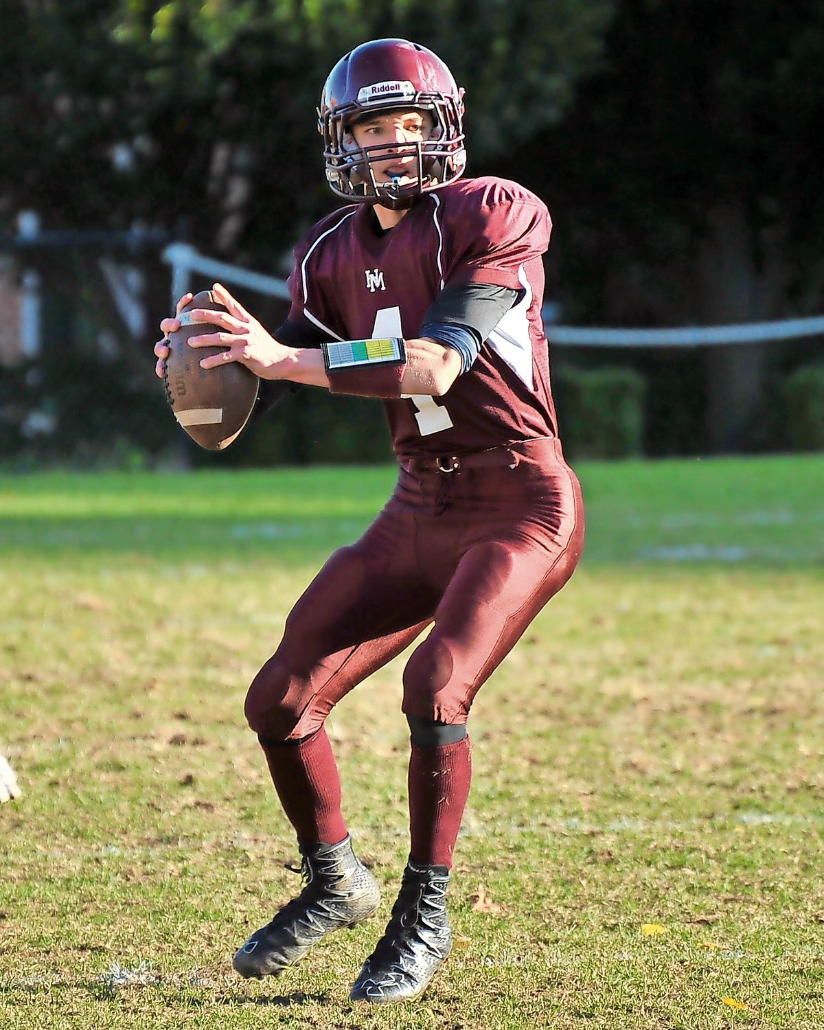 Horace Mann senior quarterback Brody McGuinn helped the Lions capture their third league title in four seasons with a TD pass in a 14-6 victory over Dalton.