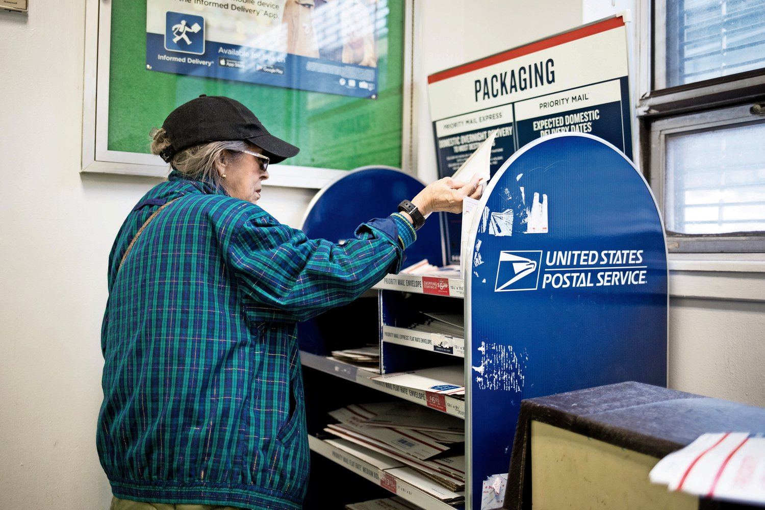 A customer selects an envelope at the Kingsbridge post office. If U.S. Rep. José Serrano has his way, affordable banking services would return to post offices like this one throughout the country.