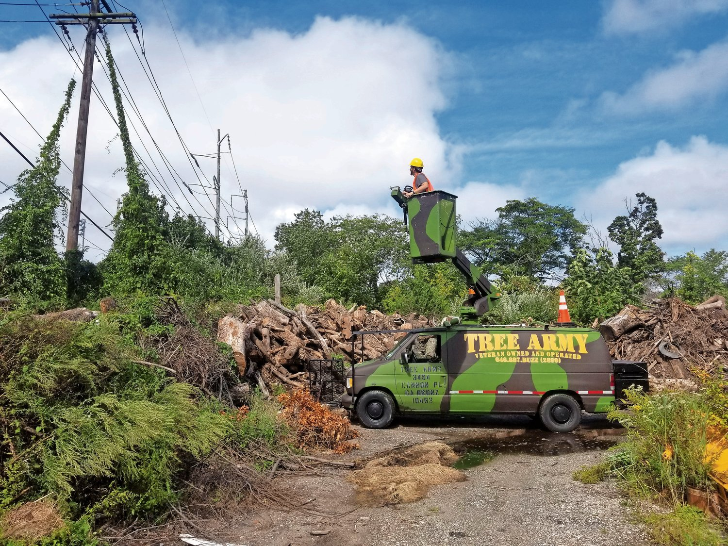 Tree Army, a company owned and operated by veterans, specializes in the removal of unwanted trees. During the holiday season, they also donate the use of their vehicles for the Marine Corps' Toys for Tots program.