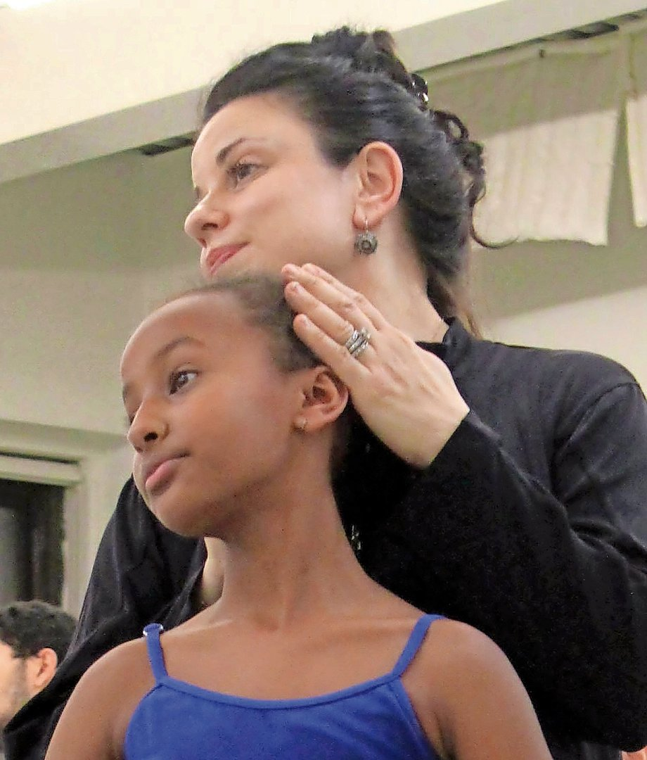 Jenna Lavin guides a student during a lesson at Ballet Academy East. After 16 years of teaching at Ballet Academy East, Jenna Lavin is now the principal of the academy.