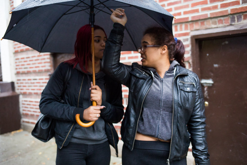 Alexandra Dalrymple, right, talks about crime in her Kingsbridge Heights neighborhood near Webb Avenue. Despite the New York Police Department's statistics showing citywide crime plummeting to historically low levels, Dalrymple and fellow resident Destiny Martinez, left, feel murders, robberies and other violent incidents still plague their streets way more than they'd like.