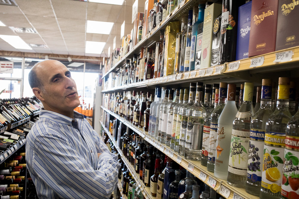Gary Wartels, owner of Skyview Wine & Spirits and president of the North Riverdale Merchant and Business Association, looks through his shop's bottle selection. If recreational marijuana is legalized in New York, Wartels strongly supports allowing liquor store owners to sell it, rather than excluding them from a potentially lucrative market.