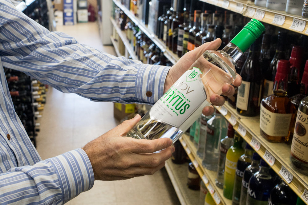 Gary Wartels, who runs Skyview Wine & Spirits in North Riverdale, holds a bottle of Spirytus — a grain spirit containing some 96 percent alcohol. As the state moves closer to implementing a legalized recreational marijuana program, Wartels enthusiastically backs granting mom-and-pop liquor shop owners the right to sell weed in their stores.