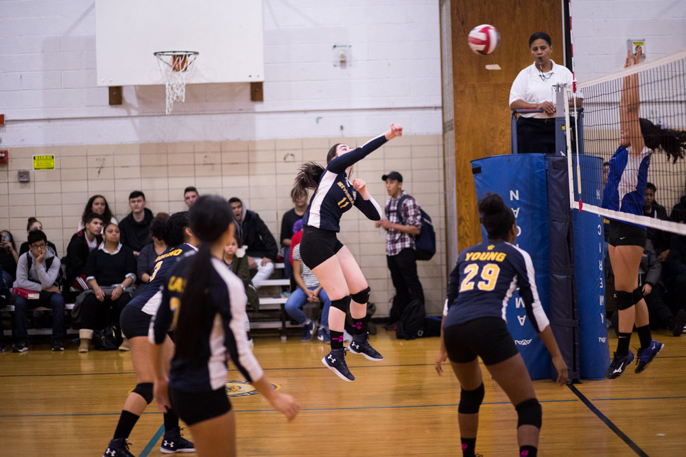 RKA's Ketrina Alika launches one of her nine kills in last week's PSAL playoff win over Baruch.