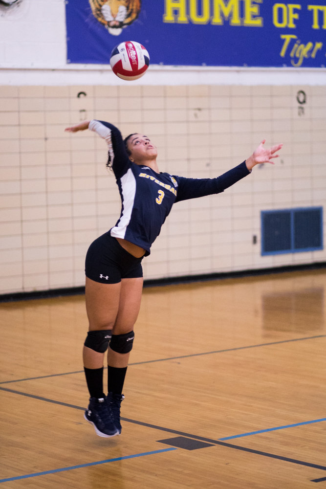 RKA's Krystal Paulino prepares to serve during the Lady Tigers' straight-set victory over Baruch in a PSAL playoff first-round victory.