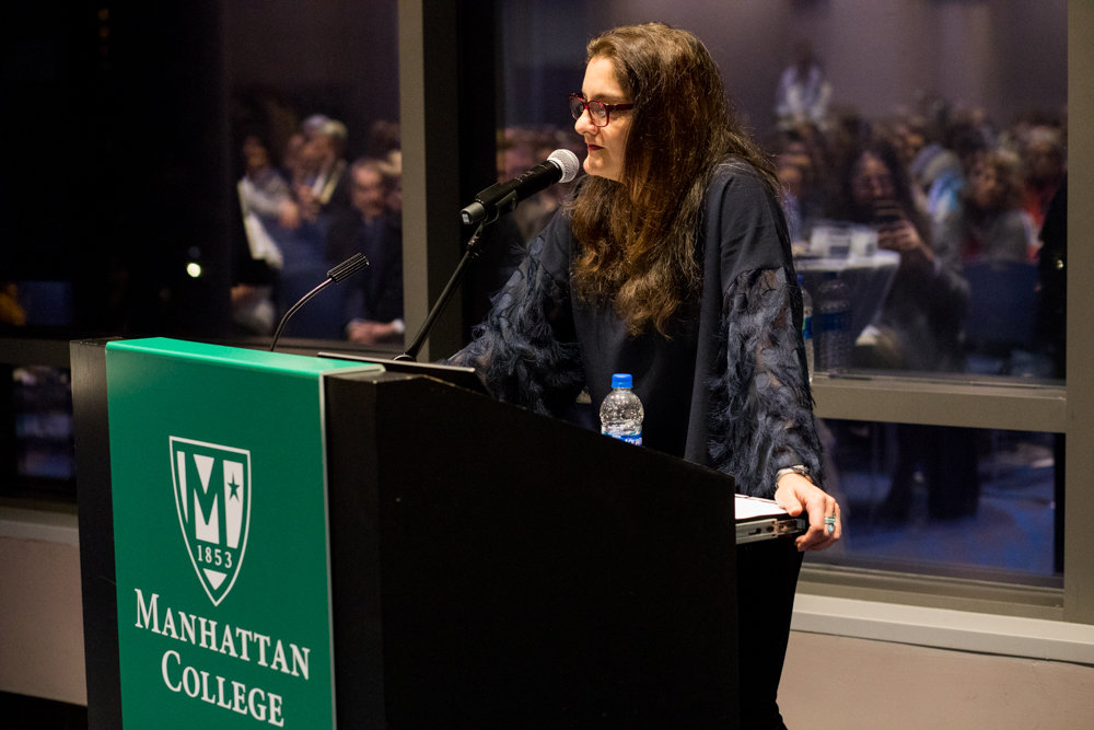 Mehnaz Afridi, a professor of religious studies at Manhattan College, gives opening remarks at a remembrance of Kristallnacht, a 1938 pogrom against Jews during World War II.