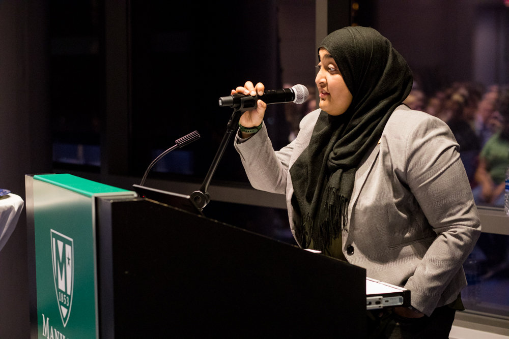 Rabea Ali, president of the Muslim Students Association at Manhattan College, speaks about Kristallnacht during a remembrance ceremony marking 80 years since the pogrom against Jews.