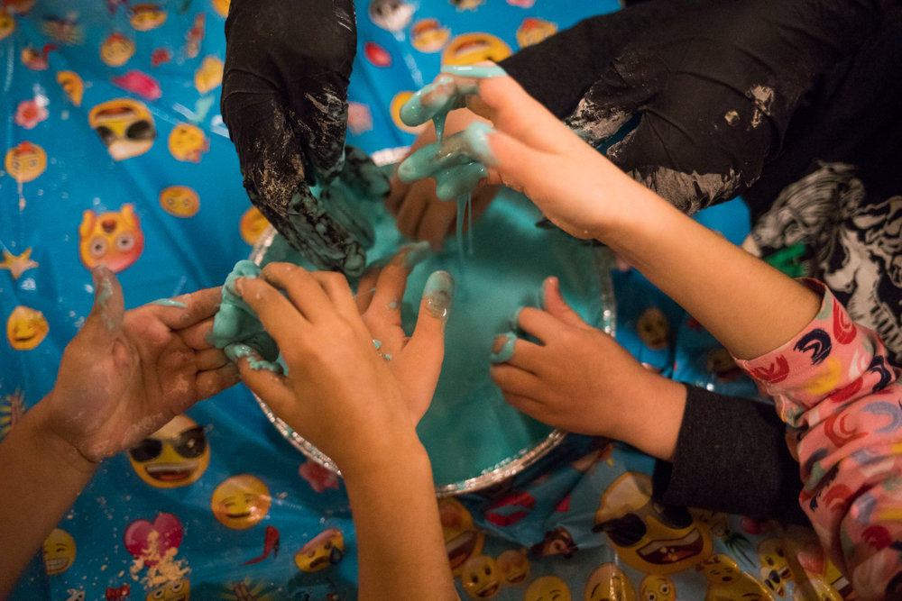 P.S. 24 students get their hands dirty with slime at Manhattan College during STEM Junior Day. The National Society of Black Engineers' goal is to help students become interested in science through fun activities like coloring and slime making.