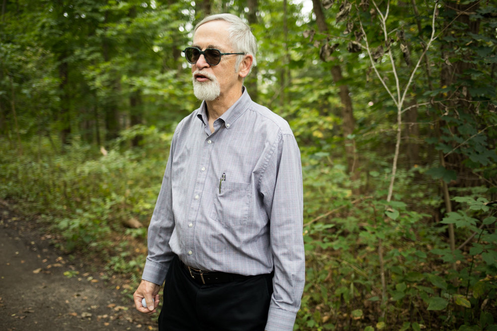 Manhattan College professor William Merriman has trotted along the Old Putnam Trail in Van Cortlandt Park three times a week for 30 years. He opposes a plan to pave a large section of the trail, preferring instead a soft surface. 'I feel like when I'm walking here, I'm in the country.'