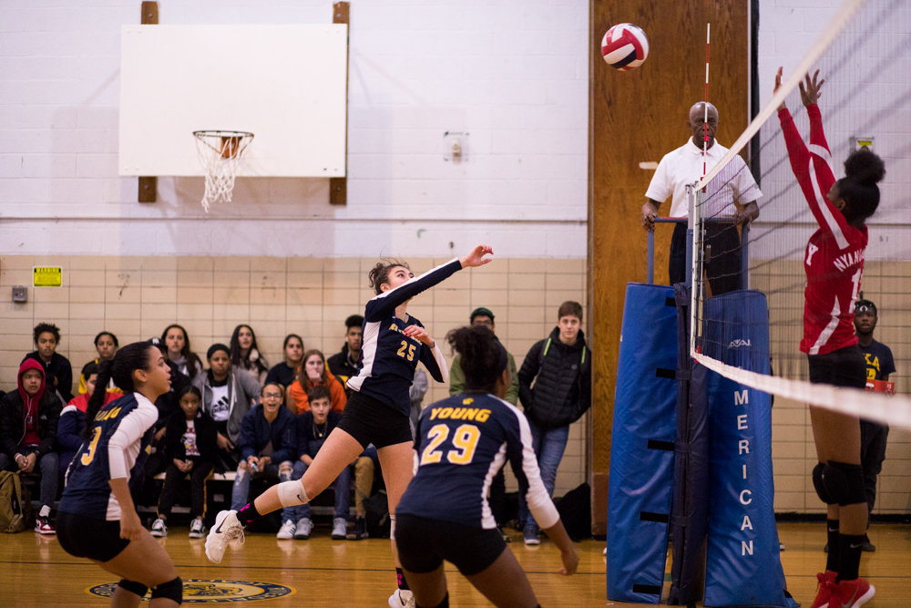 RKA junior Zahra Jafar uncorks one of her two kills in the Lady Tigers' playoff victory over John Dewey.