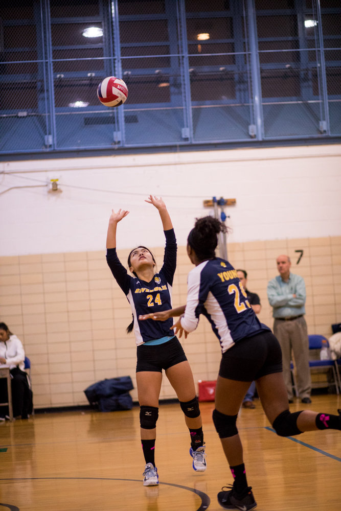 Patricia Casino sets up teammate Kiana Young with one of her 21 assists in RKA's playoff win over John Dewey.