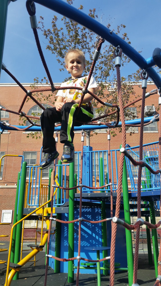Julian Serafin enjoys a playground in 2016. He was diagnosed with medulloblastoma in 2015, and died at the young age of 8 from the disease last July. P.S. 24 Spuyten Duyvil, where he was a student, recently dedicated a plaque in his honor.