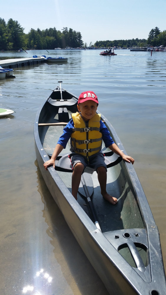 Julian Serafin sits in a canoe in 2017. He was diagnosed with medulloblastoma in 2015, and died last July at the young age of 8. Julian's school, P.S. 24 Spuyten Duyvil, recently dedicated a plaque in his honor.