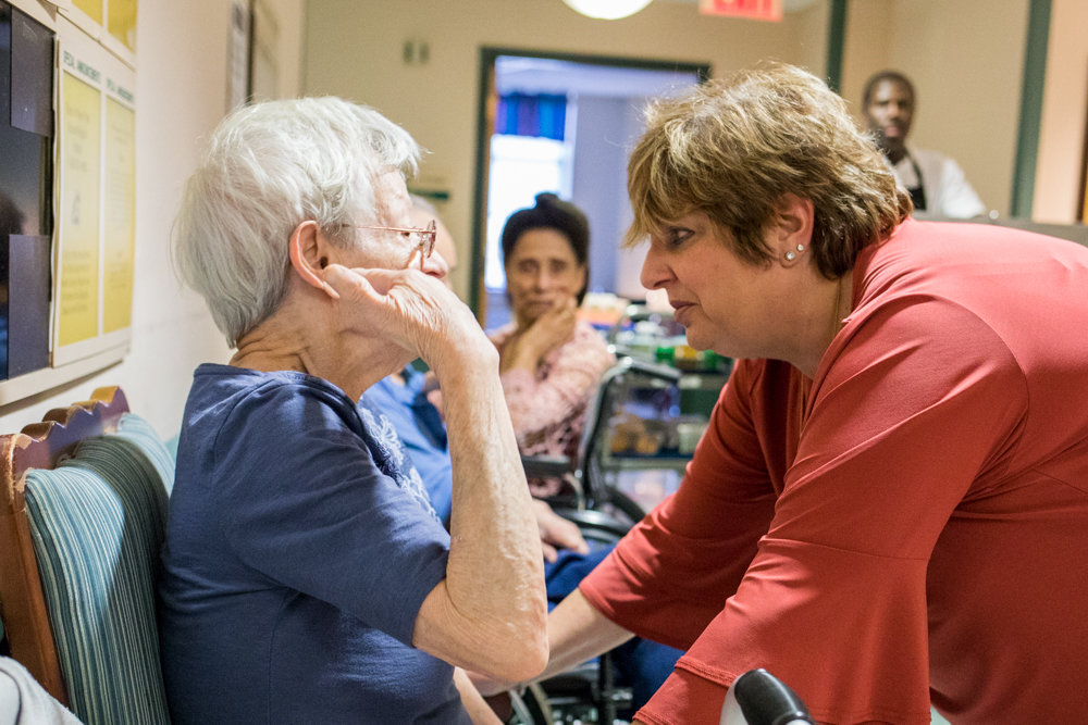 Franca Martino-Starvaggi checks up on a patient at the Schervier Nursing and Rehabilitation Center. Martino-Starvaggi works as the director of social work. She has helped others for more than three decades.