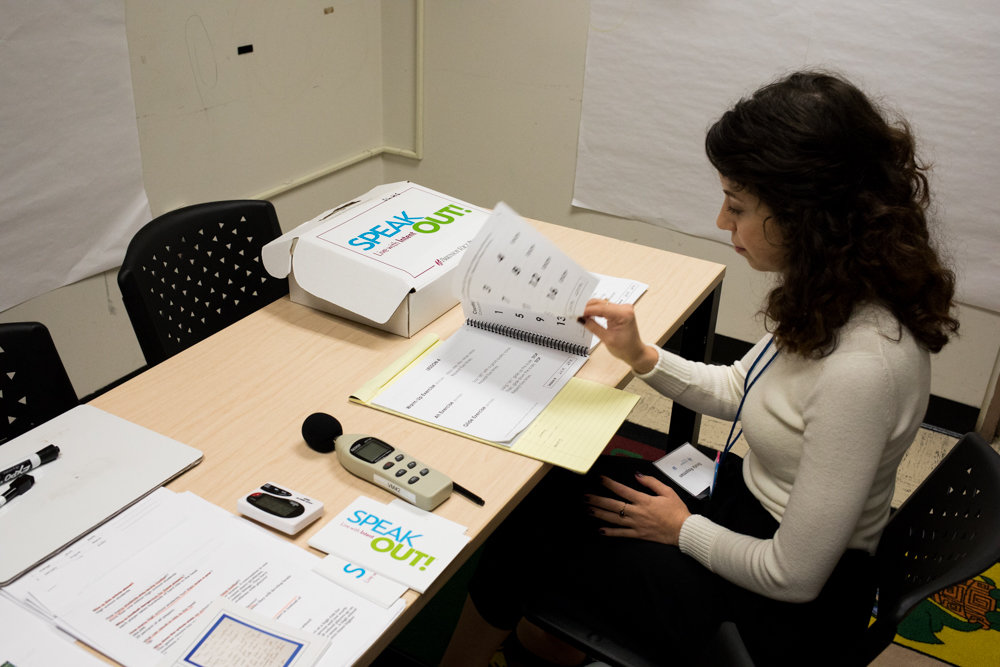 Beata Royzman reads through material ahead of a session with a patient in Lehman College's new Parkinson's disease clinic. Royzman is a graduate student in Lehman's speech-language pathology program. Inspired by music, Royzman helps clients with their voice through speech therapy.